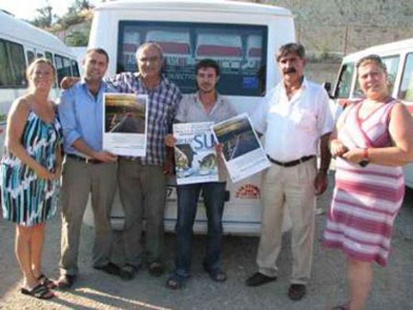 Küçükkuyu'da Minibüslere HAYTAP Kampanya Afişleri Asıldı